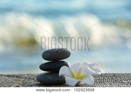 Spa stones with flowers outdoors