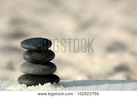 Spa stones on sand beach close up