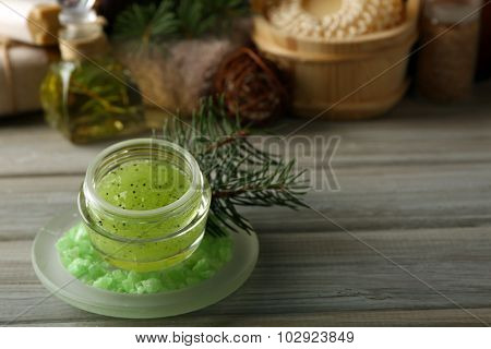 Face scrub and Spa treatments with pine extract on wooden background