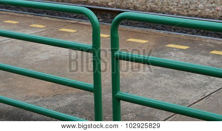 Green Metal Fence And Yellow Dash Line