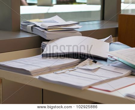 Pile Of Document On Desk At Office
