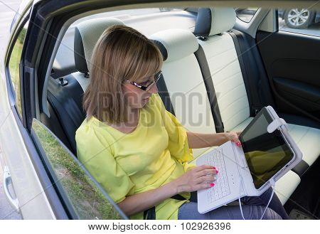 Businesswoman With Document And Laptop