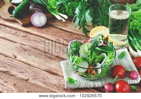Vegetable Salad With A Glass Of Water On The Table