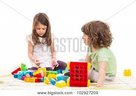 Kids Playing With Bricks Toys