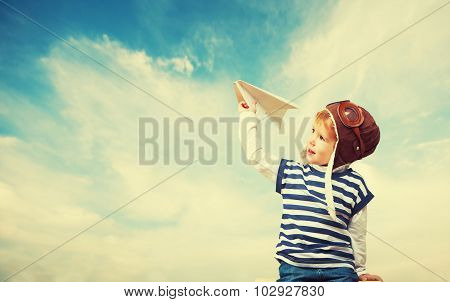Happy Child Dreams Of Becoming Pilot Aviator And Plays With Planes In Sky
