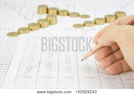 Man Holding Pencil For Audit Have Blur Step Gold Coins