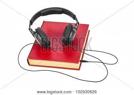 Headphones and book isolated on white background