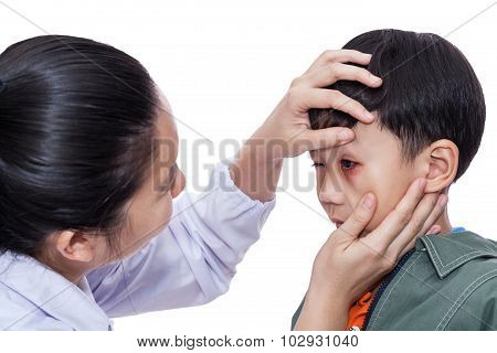 Boy With An Injured Eye. Doctor Examining And First Aid A Patient. White Background