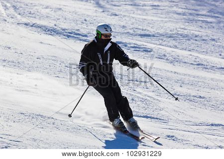 Skier at mountains ski resort Bad Gastein Austria - nature and sport background