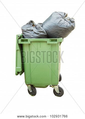 Trash Can Surrounded By A Bunch Of Garbage Bags Isolated On White Background