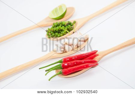 Ingredients Of Thai Food On Wooden Spoon (chili, Pepper, Garlic And Lemon)