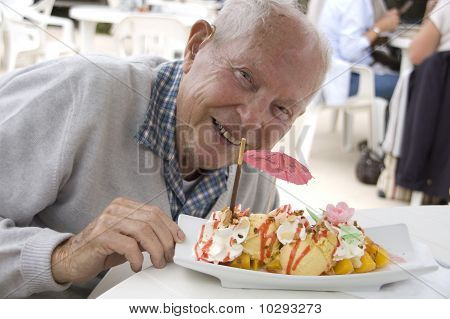 Old Senior Man With Sundae