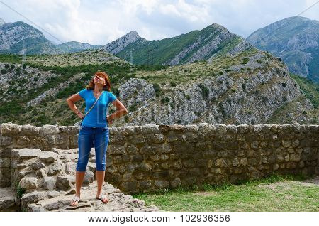 Young Woman Stands On Stone Wall Of Fortress In Old Bar