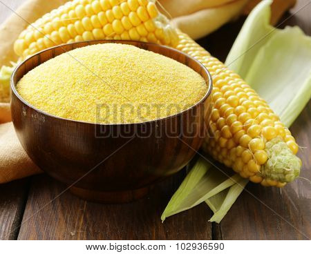 Natural organic corn grits and cobs on the wooden table
