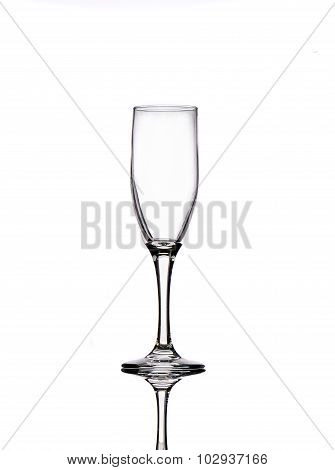 Empty Champagne Glass With Reflection On White Background