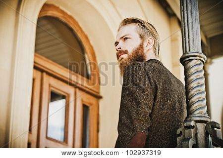 Portrait of young beautiful fashionable man outdoor