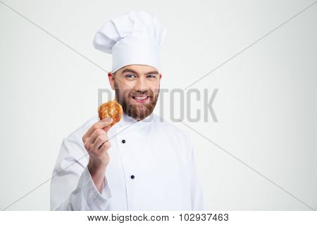 Portrait of a happy male chef cook holding pancake isolated on a white background