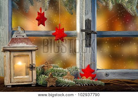 Lantern on window sill in winter mood