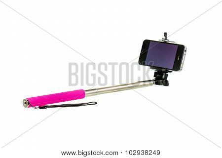 Extension Selfie Stick With An Adjustable Clamp On The End With Mobile Phone On White Background