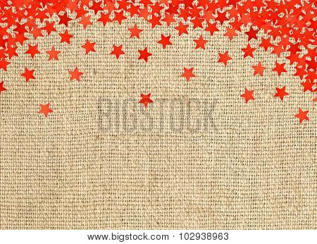 Red Stars On Linen Texture Background