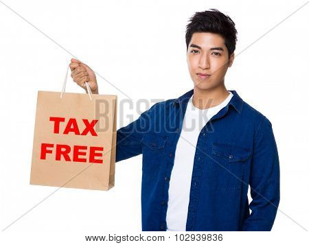 Man hold with shopping bag and showing phrase of tax free