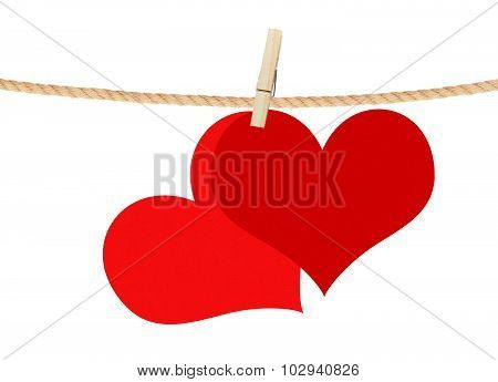 Two Red Hearts Hang On Clothespin Isolated On White Background