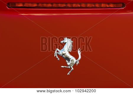 Ferrari Logo On The Back Of A Red Ferrari