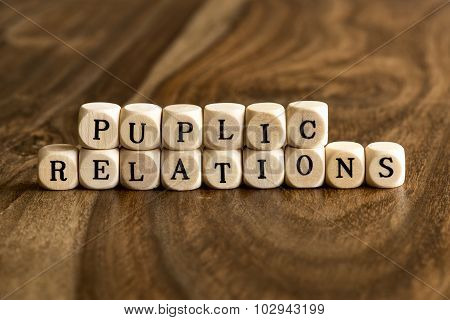 Word Puplic Relations On Wooden Cubes