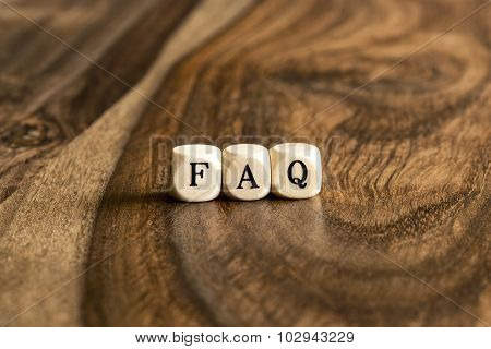 Word Faq On Wooden Cubes