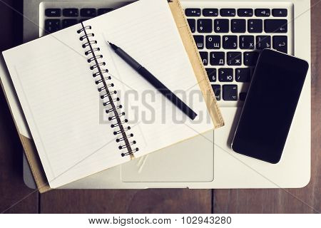 Open Notebook, Cell Phone And Laptop