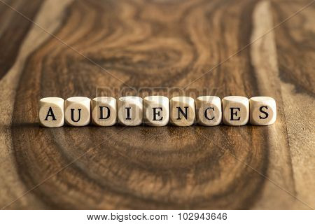 Word Audiences On Wooden Cubes