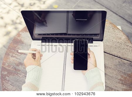 Schoolgirl With Blank Diary, Laptop And Smartphone Outside