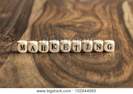 Word Marketing On Wooden Cubes