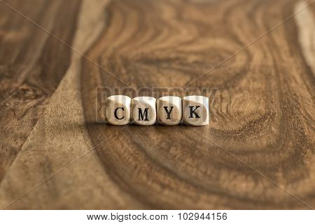Word Cmyk On Wooden Cubes