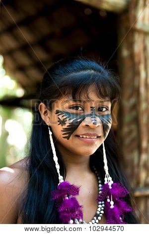Native Brazilian girl at an indigenous tribe in the Amazon
