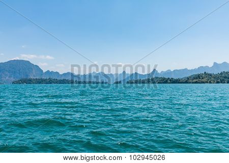 Blue Clear Water With Rock Mountains Reservoir Lake At Ratchaprapa Dam Surat Thani, Thailand