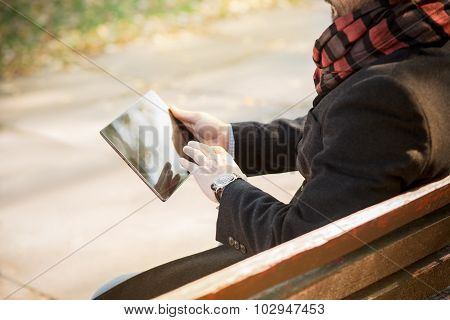 Tablet PC close-up in man's hands
