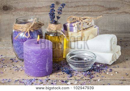 Lavender Oil, Lavender Flowers, Handmade Soap  And Bath Towels, Sea Salt And A Burning Aromatherapy
