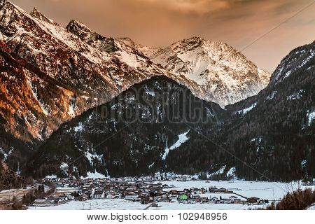 Sunset winter snow covered mountain valley in Austrian alps. Solden