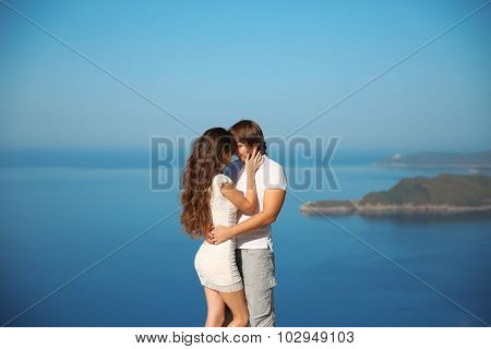 Passionate Couple Kissing Over Sea And Blue Sky Background. Enjoyment. Holidays, Vacation, Love And