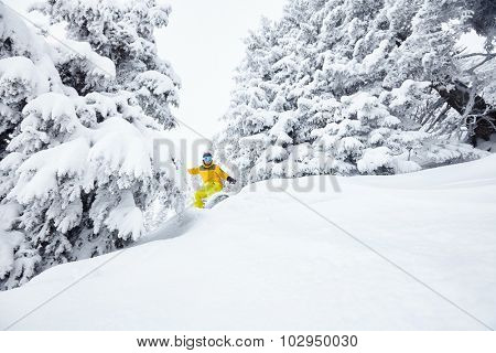 Male snowboarder having fun in deep backcountry powder snow during winter blizzard in Alps - extreme sports concept