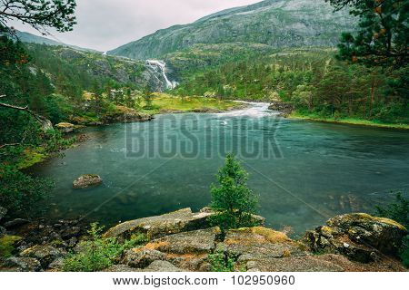 Husedalen - Valley of waterfalls Norway. Giant Tall Waterfall