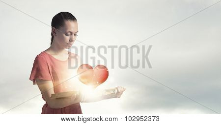Young emotional woman in red dress with book in hand