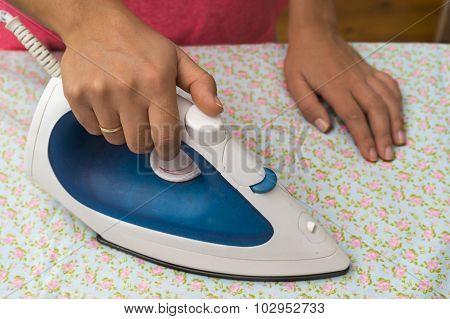 Woman ironing sheet