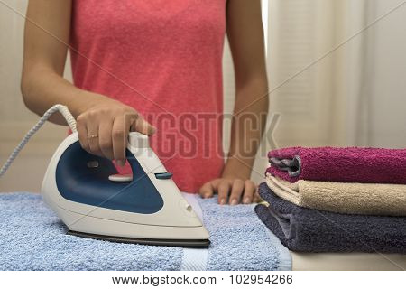 Woman ironing towels