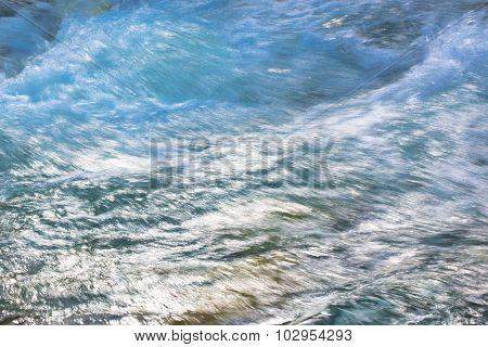 Close up of a waterfall  in the river during high water flow