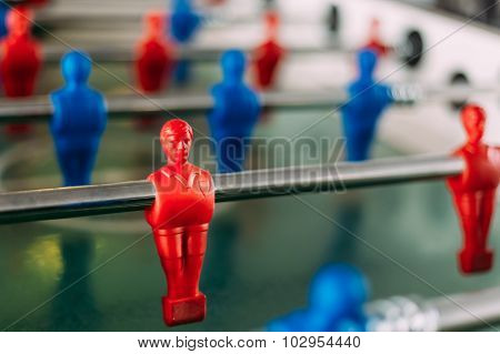 Table football game with red and blue players. Red Foosball Play