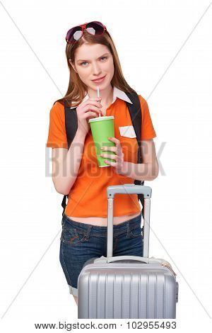 Smiling girl with backpack and suitcase