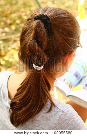 Teen Girls Head With Brown Thick Plate Rear View