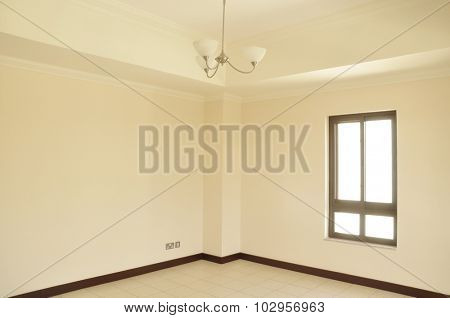 An empty room with window.